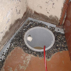 Installing a sump in a sump pump liner in a Olympia  home
