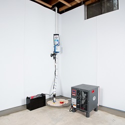 Sump pump system, dehumidifier, and basement wall panels installed during a sump pump installation in Kingston
