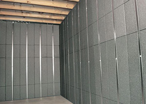SilverGlo™ insulation and metal studs making up our Basement to Beautiful panels.  Installed in Tacoma.
